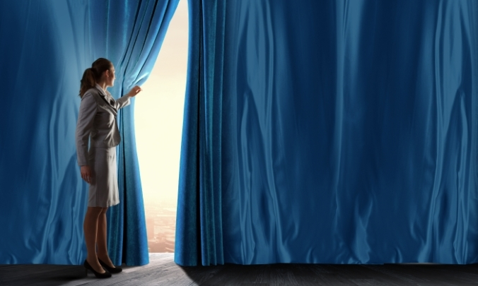woman opening curtain looking at stage or audience
