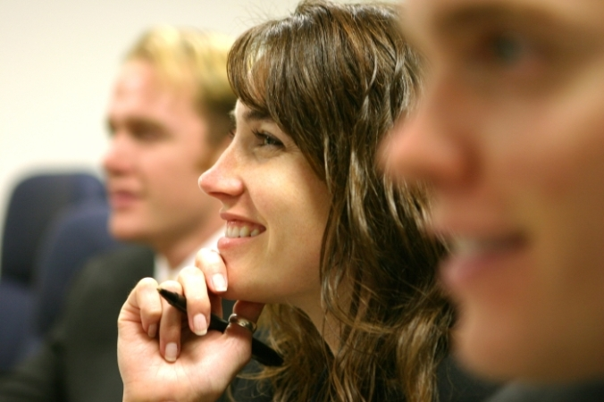 Smiling woman listening